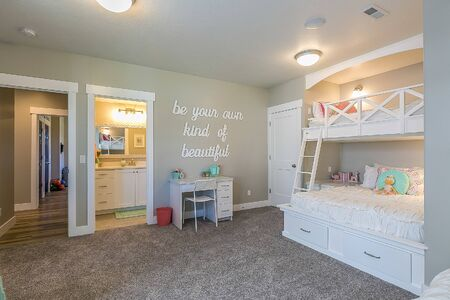 Girls bedroom with four bunk beds and little desk