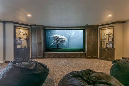 Large projector screen in theater room with plenty of room for friends