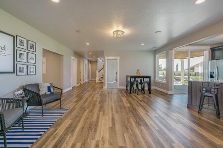 Open space in basement connected to kitchen, exercise room and theater room