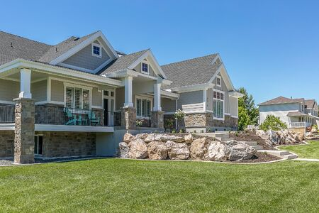 Big beautiful home with a boulder wall for elevation Stock fotó