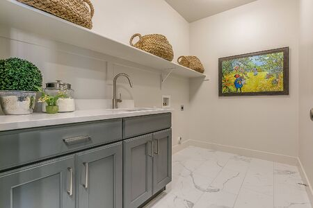 Great staged laundry room but without a washer and dryer Archivio Fotografico