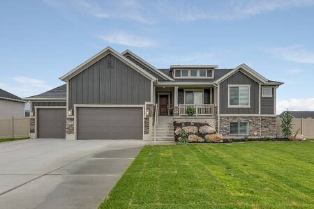 Three car garage with steps leading to front door