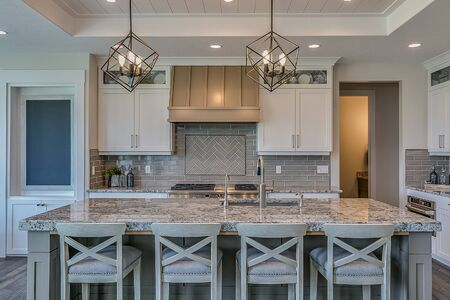 Classy kitchen from the wood flooring to the tray ceiling
