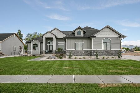 Beautiful new home with long walkway connecting driveway to front door Stockfoto