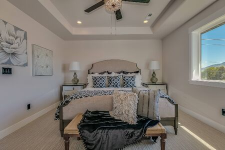 Beautiful tray ceiling above king size bed in master bedroom