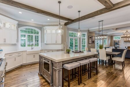 This kitchen has a massive island and is the heart of the home