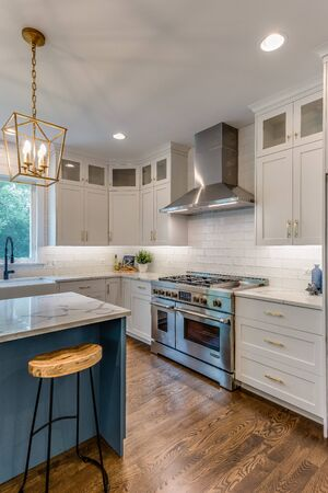 Gourmet white kitchen with large island perfect for hosting