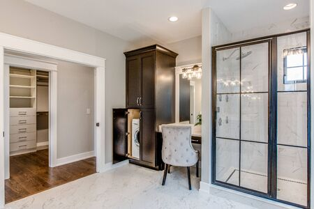 Glorious master suite with laundry, vanity, window pane shower and freestanding tub
