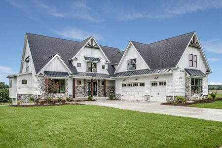 Beautiful modern farmhouse design with three car garage
