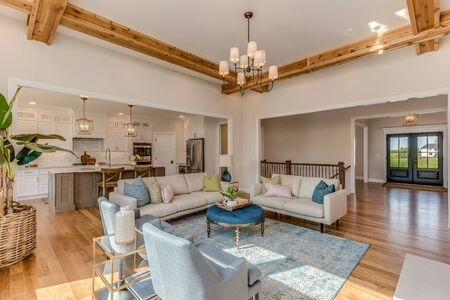 Open family room with coffered ceiling that enhances trim detail
