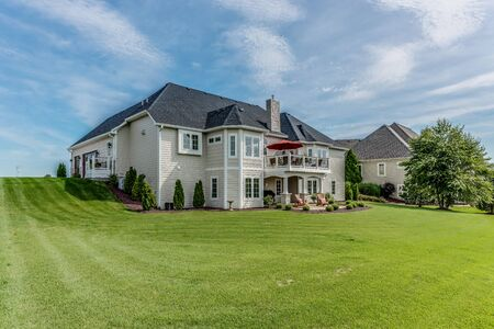 Rear exterior of large home with walk out basement to spacious back yard