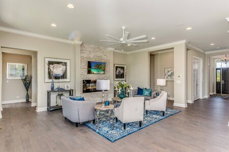 The large great room is the center of attention and flows into the designer kitchen