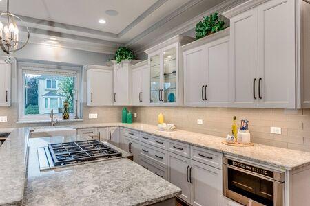Elegant white kitchen with quartz countertops