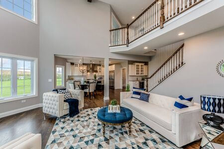 Soaring two story great family room with large windows Archivio Fotografico