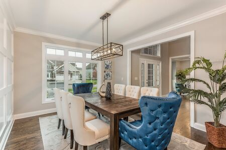 Formal dining room that connects to the two story foyer