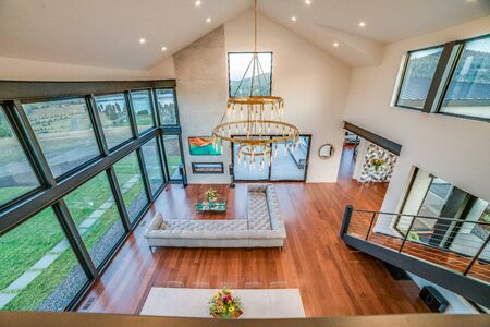 Upstairs loft with an amazing view of the great room below and the scenery outside Stock Photo