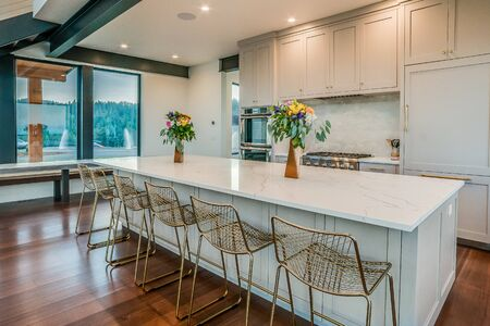 Modern white kitchen with an amazing view