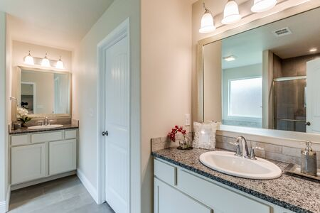 Large master bathroom with his and hers vanities and separate garden tub and shower