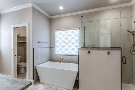 Modern private master suite with freestanding tub and large shower Stock fotó