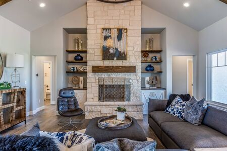 Modern farmhouse family room with vaulted ceiling