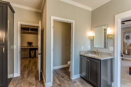 Master suite connects to large laundry utility room Imagens