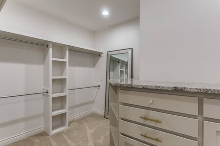 Walk in closet with dresser and lots of space Foto de archivo