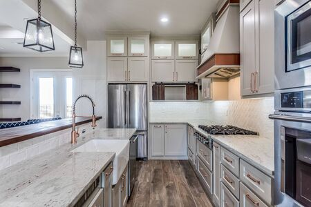 Amazing new kitchen with all the amenities, like a handcrafted cutting board Stock Photo