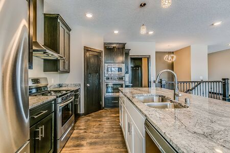 Lovely kitchen with granite countertops and built-in oven