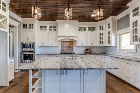 Immaculate kitchen with pine ceiling and stainless steel appliances