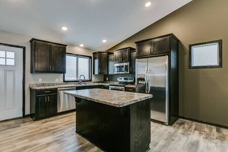 Front door opens right next to kitchen with open layout