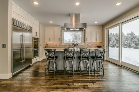 Marvelous and spacious kitchen with large gas range on the island