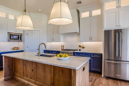 Beautiful kitchen with floor to ceiling custom built cabinets and quartz countertops