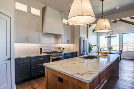 Beautiful kitchen with floor to ceiling custom built cabinets and quartz countertops Stock fotó