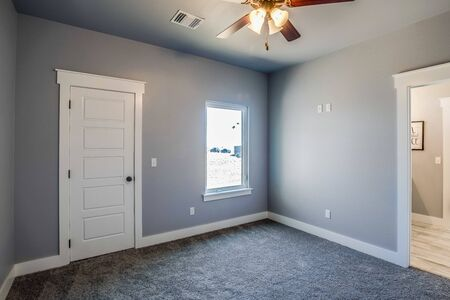 Guest bedroom with door to the outside