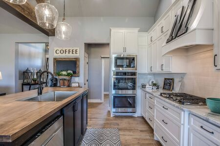 Beautiful white and brown kitchen in showcase home