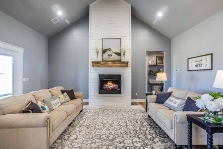 Living area that features large stained beam and amazing shiplap fireplace