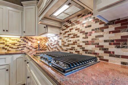 Tile backsplash behind new gas cooktop