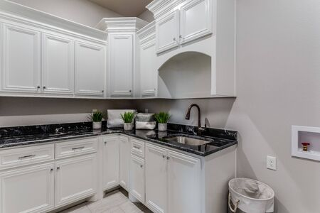 Light and dark colors are a perfect mix in this laundry room