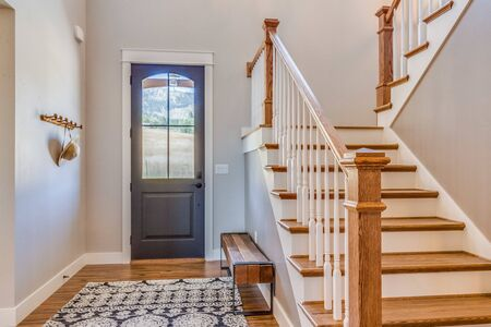Welcoming front entry with open staircase