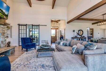 Modern farmhouse aesthetic is present as you enter the great room