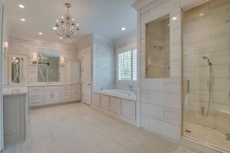 Bright white bathroom with painted wood walls