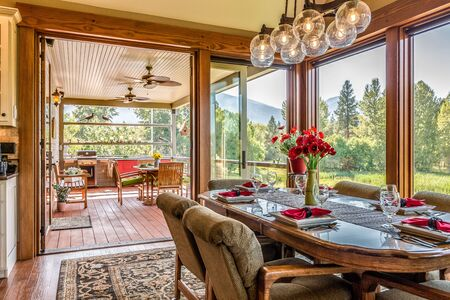 Glass walls and doors separating the dining area from outside