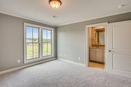 Empty bedroom with brand new carpet