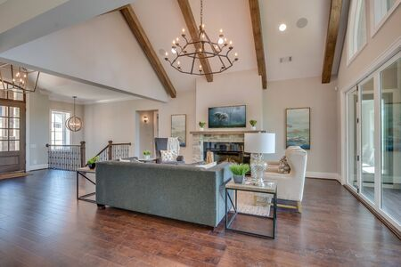 Wood beams and vaulted ceiling in great room