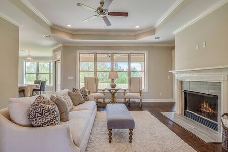 Expansive living room with lots of windows.