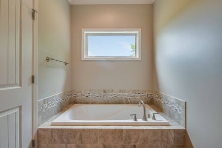 Close up of soaking tub in master suite