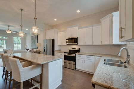 Light colors in this beautiful kitchen make it bright