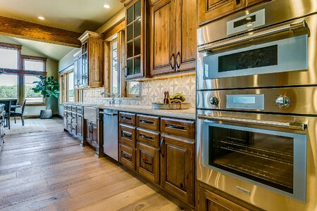 Kitchen galley with double oven and farmhouse sink
