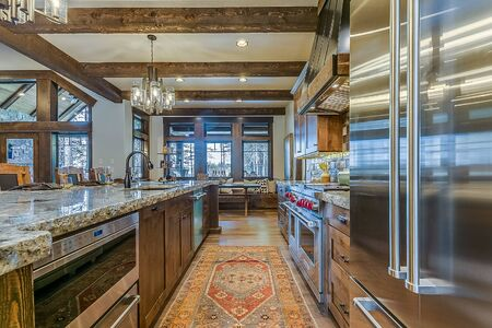 Wood beam ceiling above amazing kitchen galley