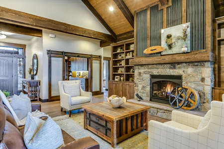 Rustic modern living room with stone fireplace